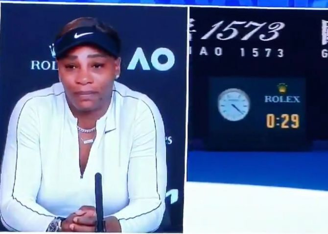 Serena Williams holds back tears while answering questions during a press conference after her semi-final loss to Naomi Osaka at the Australian Open in Melbourne on Thursday
