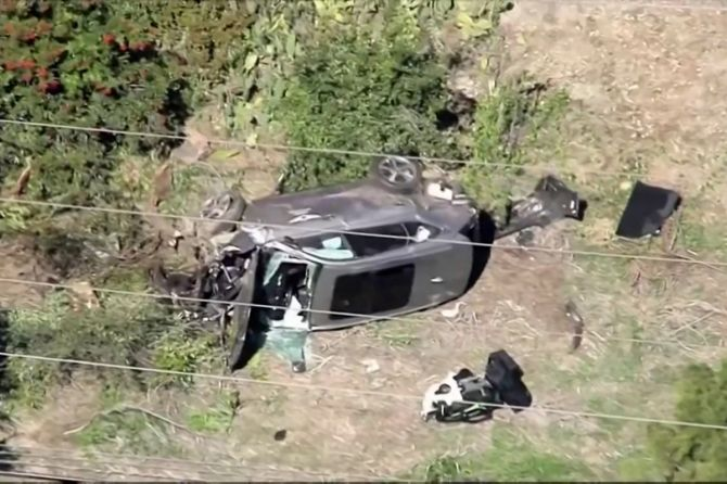 In a still image from video taken on Tuesday, the vehicle of golfer Tiger Woods lies on its side after being involved in a single-vehicle accident in Los Angeles