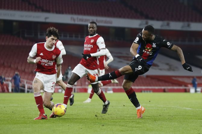 Arsenal's Hector Bellerin challenges Crystal Palace's Jordan Ayew during their Premier League match