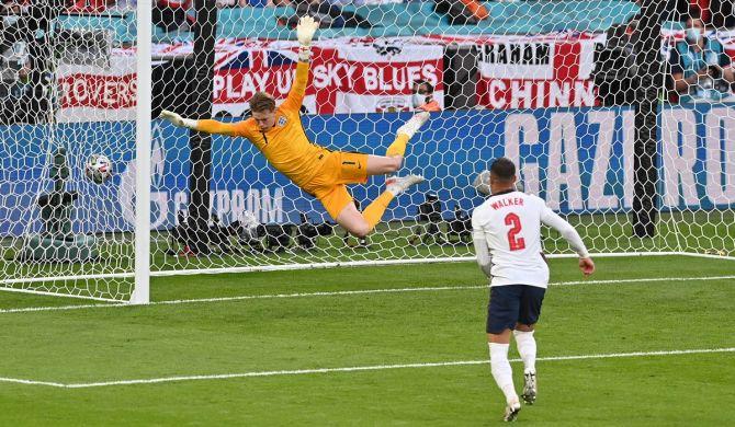 England goalkeeper Jordan Pickford makes a vain attempt to prevent Mikkel Damsgaard's free-kick crashing into the net
