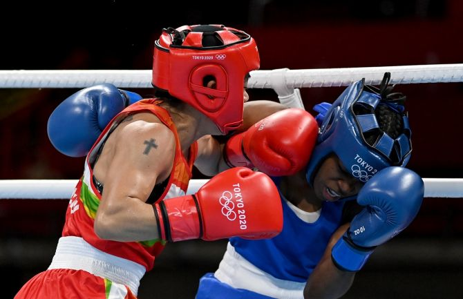 MC Mary Kom, in red, trades punches with the Dominican Republic's Miguelina Hernandez Garcia during the women's flyweight boxing bout, at Kokugikan Arena in Tokyo, on Sunday. Photograph: Luis Robayo - Pool/Getty Images