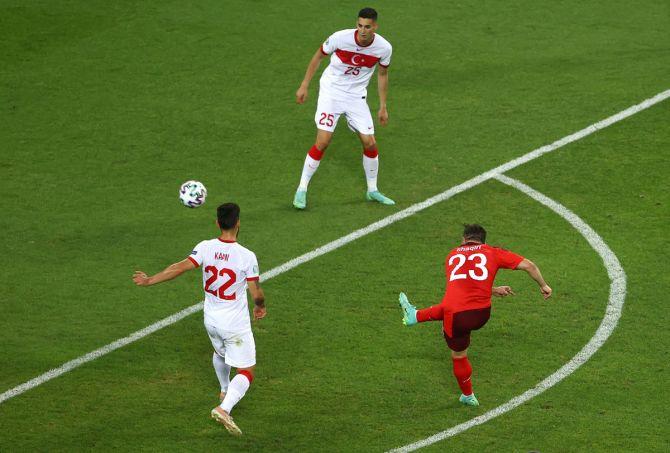 Xherdan Shaqiri curls an exquisite shot beyond the despairing dive of Turkey goalkeeper Ugurcan Cakir to score the Switzerland's second in the Group A match in Baku