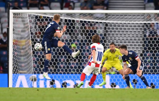 Luka Modric volleys from outside the box to score Croatia's second goal past Scotland goalkeeper David Marshall