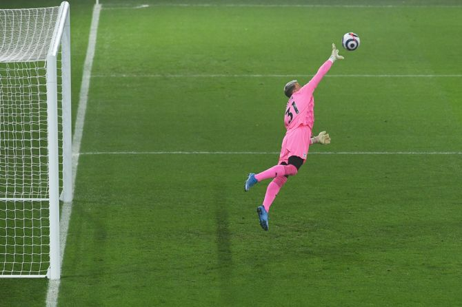 Crystal Palace goalkeeper Vicente Guaita makes a superb save during the match.
