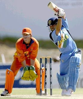 Jeroen Smits, the Holland wicket-keeper, watches Sachin Tendulkar drive on the way to 52. Tendulkar became the World Cup's all-time leading run scorer in the course of India's first World Cup game against Holland at Boland Park, Paarl.