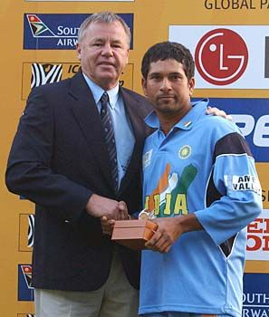 South African cricket legend Mike Proctor hands Sachin his Man of the Match trophy after the Pakistan game